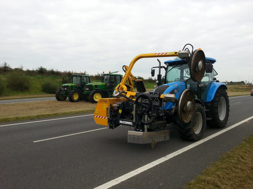 Barrier mower mounted on a tractor on the A55